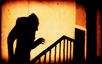 An iconic moment in expressionist cinema: Graf Orlok (Max Schrek), represented only by his shadow, ascends the stairs to Ellen's room in the finale of Nosferatu by F.W. Murnau (1922)